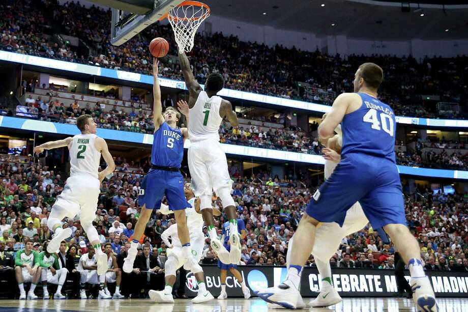ANAHEIM, CA - MARCH 24:  Luke Kennard #5 of the Duke Blue Devils goes up for a shot over Jordan Bell #1 of the Oregon Ducks in the second half in the 2016 NCAA Men's Basketball Tournament West Regional at the Honda Center on March 24, 2016 in Anaheim, California. Photo: Sean M. Haffey, Getty Images / 2016 Getty Images