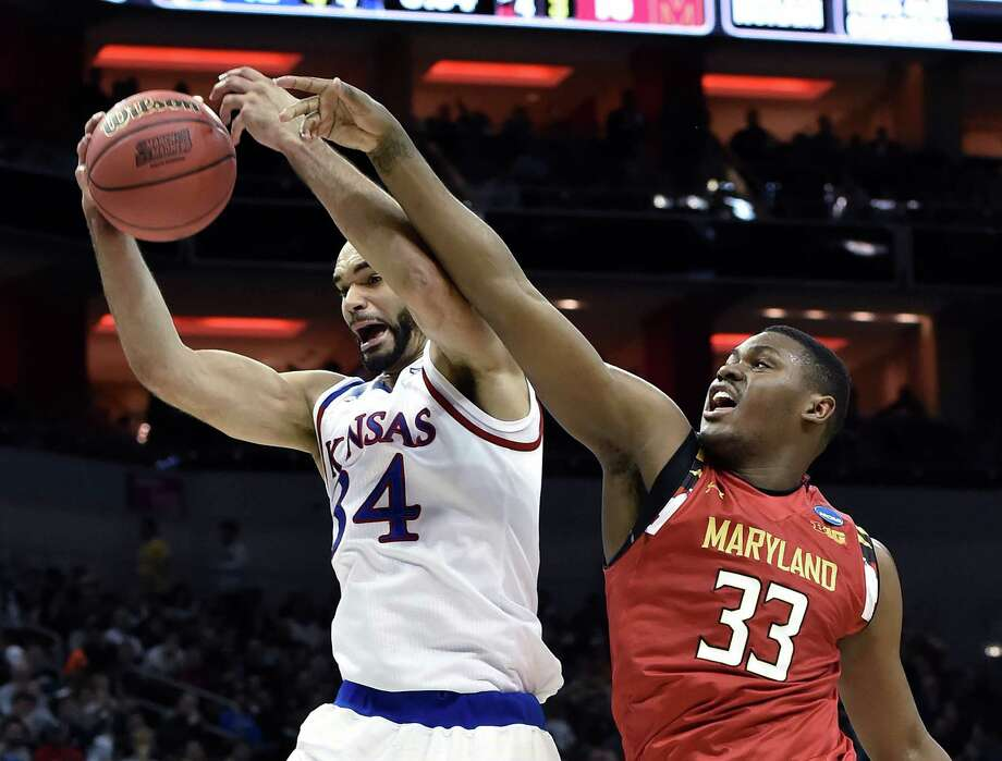 Kansas forward Perry Ellis, left, claims a rebound in front of Maryland center Diamond Stone on Thursday night. Ellis' 27 points were his highest total in nine career NCAA Tournament games. Photo: John Flavell, FRE / FR44648 AP
