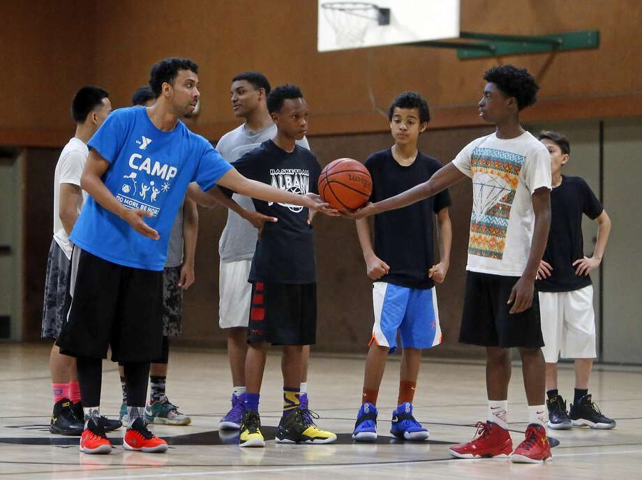 Coach Sef Seniagets the ball from Brian Davis, 15, as the East Bay Soldiers practice in Richmond, Calif., on Thursday, March 24, 2016. Photo: Scott Strazzante, The Chronicle