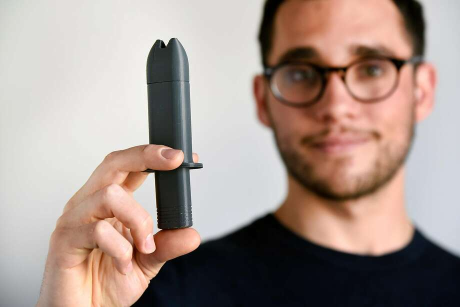 Jonathan Grossman holds a 3-D printed prototype of his naloxone nasal atomizer at the San Francisco offices of industrial design firm Frog. Photo: Michael Short, Special To The Chronicle
