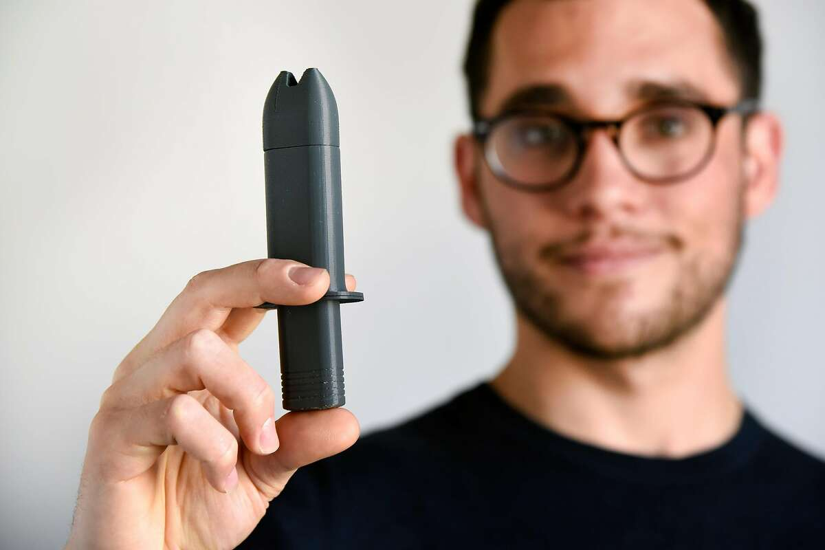 Lead industrial designer Jonathan Grossman holds a 3D printed prototype of his naloxone nasal atomizer, at Frog's offices in San Francisco, CA Wednesday, March 23, 2015. Designers at Frog have come up with a better, more user friendly device to deliver naloxone (brand name Narcan), the proven antidote to opioid overdoses, that looks like an EpiPen and appears to be an improvement over the variety of already available injectable and nasal atomizers on the market.