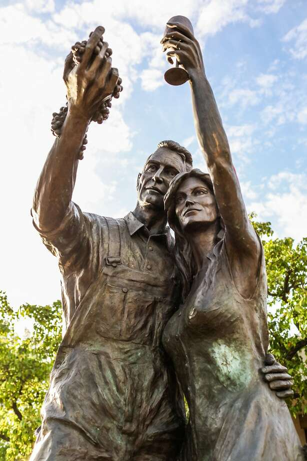 """Rowland Cheney's sculpture titled """"Celebrate the Harvest"""" sits outside the Chamber of Commerce on School Street in Lodi. Photo: Gabrielle Lurie, Special To The Chronicle"""