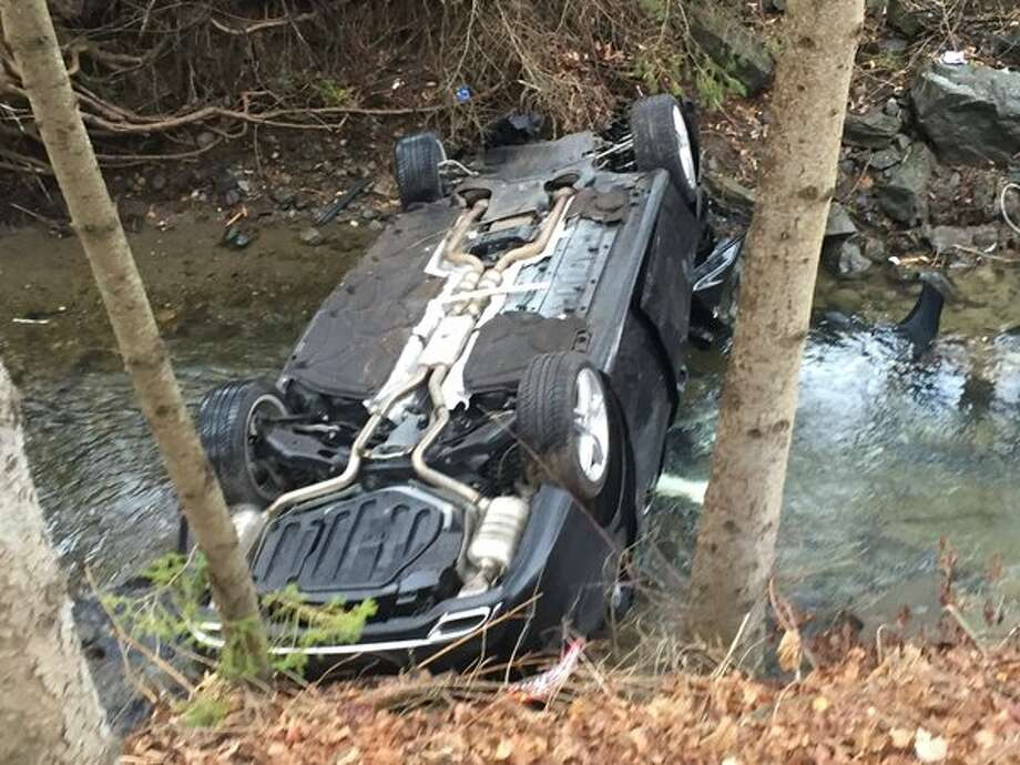 A car rolled into Mill Creek in East Greenbush Friday morning. Firefighters rescued the driver from the vehicle but it was unclear if he was badly injured. He was taken to Albany Memorial Hospital after the morning crash along Luther Road. (Kenneth C. Crowe II / Times Union)
