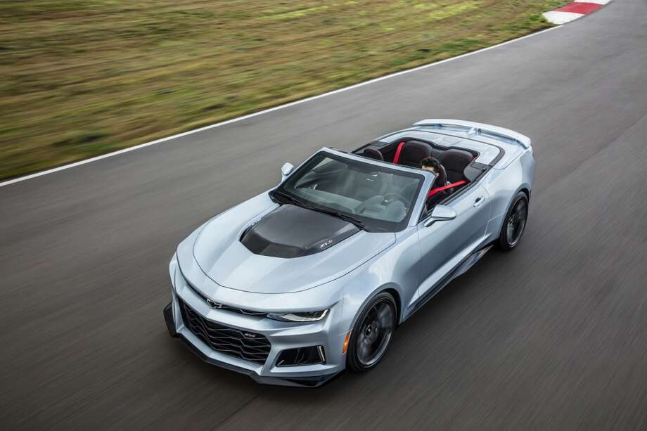 "The 2017 Camaro ZL1 is poised to challenge the most advanced performance cars in the world in any measure,€"" with unprecedented levels of technology, refinement, track capability and straight-line acceleration. From the fully automatic soft top that seamlessly disappears beneath the hard tonneau cover, to modular underbody bracing to allow the same sharp, nimble handling as the coupe, the Camaro ZL1 Convertible is a high-tech masterpiece. The fully automatic top can be raised or lowered with a single button while driving up to 30 mph, or lowered remotely with the keyfob. Photo: Chevrolet USA"