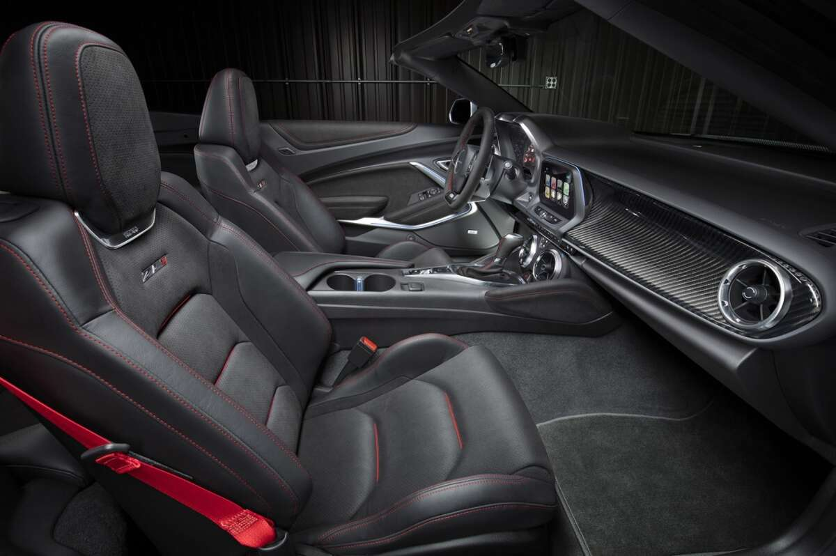 The driver-focused interior of the Camaro ZL1 features standard Recaro front seats, along with a sueded flat-bottom steering wheel and shift knob. Chevrolet'€™s Performance Data Recorder is available, allowing drivers to record, share and analyze driving experiences on and off the track. The fully automatic top can be raised or lowered with a single button while driving up to 30 mph, or lowered remotely with the keyfob.