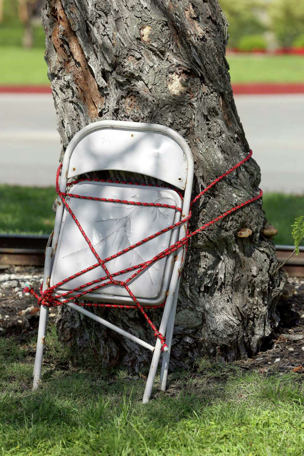 A chair marks a spot Thursday, March 24, 2016 in Brackenridge Park where someone is reserving space for their Easter festivities. Chairs of all kinds begin appearing chained, roped, and simply leaning on just about every possible object in the park as much as a week before Easter as families try to reserve good spots in the park.