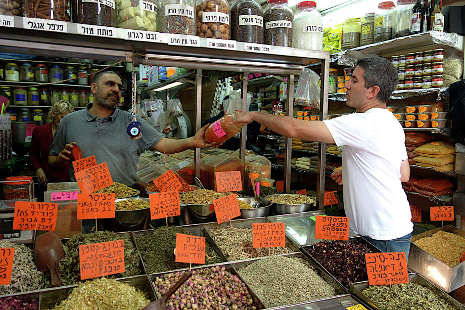 Vendors in Tel Aviv's famous Levinsky market. Photo: / / Florentine FIlm 2013