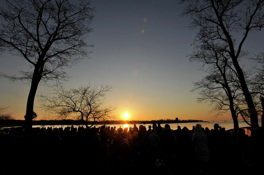 Parishoners take in the rising sun during sunrise Easter Service overlooking Long Island Sound at Cove Island Park in Stamford, Conn., on Sunday, April 5, 2015. Photo: Jason Rearick / Jason Rearick / Stamford Advocate