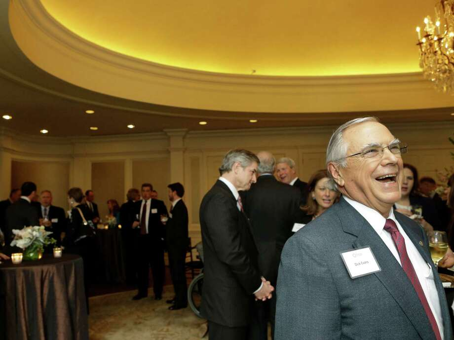 Dick Evans, chairman and CEO of Cullen/Frost Bankers Inc., talks with guests last month at a reception at River Oaks Country Club in Houston. He is retiring Thursday after 45 years at the bank. Photo: Melissa Phillip /Houston Chronicle / © 2016 Houston Chronicle
