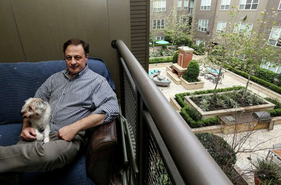 Greg Audel and his dog, Kirby, sit on the porch overlooking the courtyard of his Montrose apartment complex on Wednesday, March 23, 2016, in Houston. ( Elizabeth Conley / Houston Chronicle ) Photo: Elizabeth Conley, Staff / © 2016 Houston Chronicle