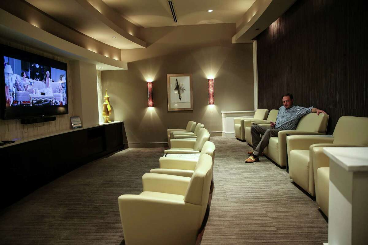 Greg Audel sits in the screening room in his Montrose apartment complex on Wednesday, March 23, 2016, in Houston. ( Elizabeth Conley / Houston Chronicle )