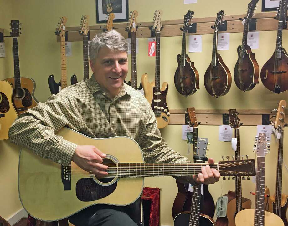 Above, Phil Williams, of New Canaan Music, with a Martin D12-35 1965 50th Anniversary Dreadnought. Photo: Justin Papp / Hearst Connecticut Media / New Canaan News
