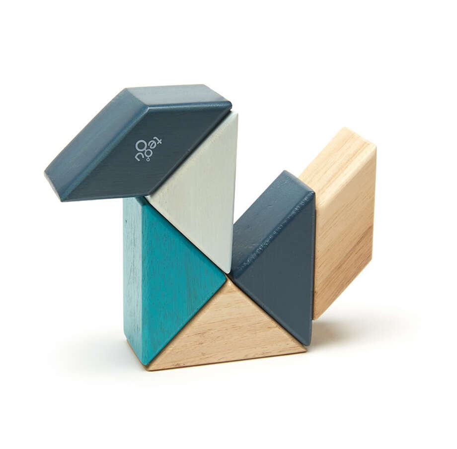 Tegu blocks attach to one another via hidden magnets.