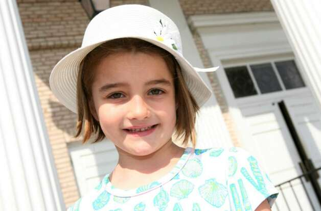 Christina Nicole Pastore, age 6, wore a hat she picked out her self to Easter services at St. Catherine of Siena Church Sunday morning. Photo: David Ames, David Ames/For Greenwich Time / Greenwich Time