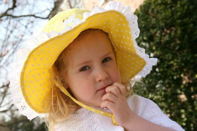 Maeve Carey, age 3, attended Easter services at St. Catherine of Siena Church in a beautiful hat Sunday morning. Photo: David Ames, David Ames/For Greenwich Time / Greenwich Time