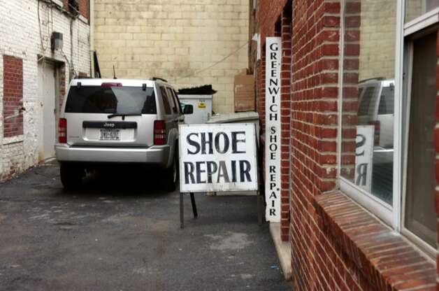The Greenwich Shoe Repair on 15 East Elm Street, in March 2010. Photo: Helen Neafsey / Greenwich Time