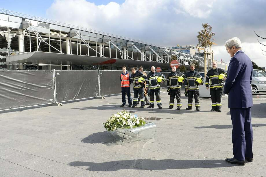Secretary of State John Kerry participates in a wreath-laying with firefighters at Brussels Airport. Photo: Frederic Sierakowski, AP