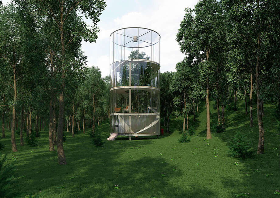 """Architecture firm A.Masow, in Kazakhstan, is giving new meaning to the concept of a """"green home"""" by designing a glass structure around a grand fir tree in the middle of a lush forest. Photo: A.Masow"""