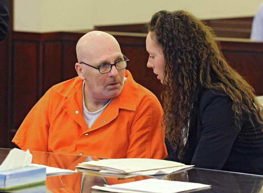 Robert Lake, left, talks to Assistant Public Defender Angela Kelley during his sentencing appearance on Friday, March 25, 2016 in Albany, N.Y. Lake, who was found guilty of stabbing his girlfriend to death, was sentenced to 23 to life in prison. (Lori Van Buren / Times Union) Photo: Lori Van Buren / 10035971A