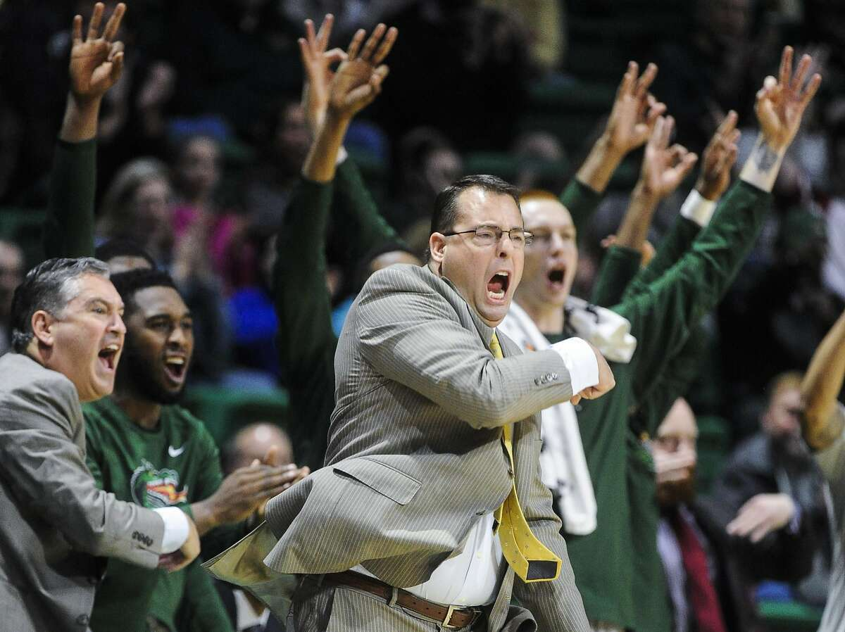 FILE - In this Jan. 9, 2016, file photo, UAB head coach Jerod Haase celebrates a basket along with his bench during the first half of an NCAA college basketball game against UTEP in Birmingham, Ala. The Blazers have one of the best records in major college basketball and a 25-game home winning streak. Still, they�ll likely have to win the Conference USA Tournament to get into the NCAA Tournament via the automatic bid for a second straight season. (AP Photo/John Amis, File)