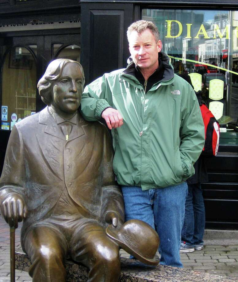 Pulitzer Prize winner Timothy Egan with a bronze of Oscar Wilde in Galway. Photo: Courtesy Photo