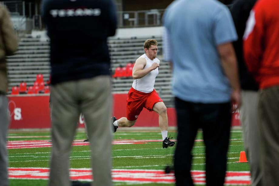 University of Houston football player Nolan Frese passes by NFL scouts as he runs the 40-yard dash during UH Pro Day Thursday, March 24, 2016 in Houston. Frese ran a 4.99. Photo: Michael Ciaglo, Houston Chronicle / © 2016  Houston Chronicle