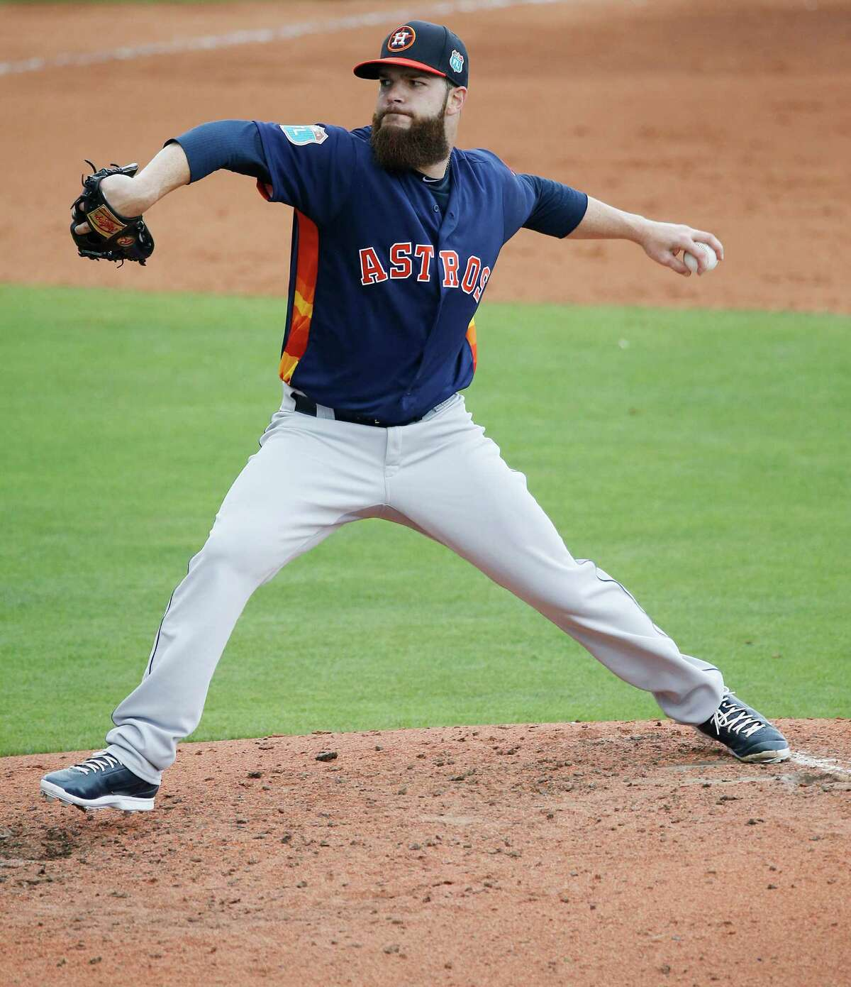 Houston Astros' starting pitcher Dallas Keuchel delivers a ball during the first inning of an exhibition spring training baseball game against the New York Mets, Thursday, March 24, 2016, in Port St. Lucie, Fla.