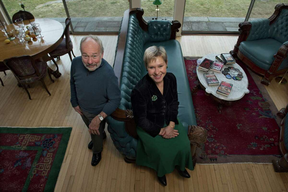 Author Justin Scott and documentary filmmaker and singer Amber Edwards at home in Newtown.