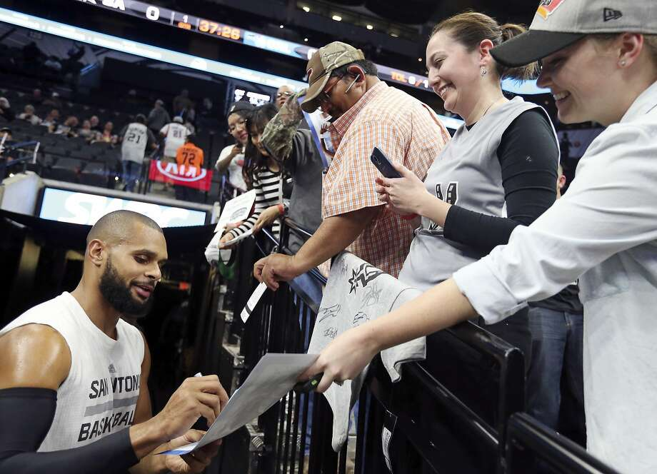 San Antonio Spurs' Patty Mills signs autographs for fans before the game with the Orlando Magic Monday Feb. 1, 2016 at the AT&T Center. Photo: Edward A. Ornelas, San Antonio Express-News