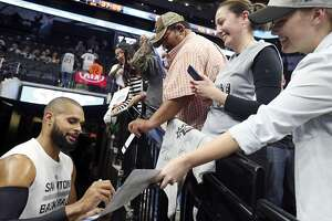 San Antonio Spurs' Patty Mills signs autographs for fans before the game with the Orlando Magic Monday Feb. 1, 2016 at the AT&T Center.