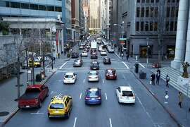Traffic on Battery Street toward Market Street in downtown San Francisco, California, on Monday, Feb. 1, 2016.