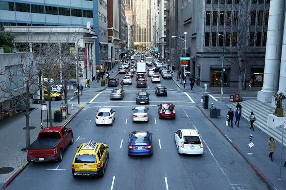 Traffic on Battery Street toward Market Street in downtown San Francisco, California, on Monday, Feb. 1, 2016.