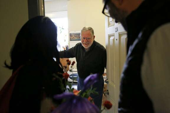 District 6 Supervisor Jane Kim, left, and Zendesk CEO Mikkel Svane, right, deliver a meal and flowers to resident Melvin Beetle for Meals on Wheels at the Raman Hotel March 23, 2016 in San Francisco, Calif. The delivery was part of Meals on Wheels' month-long campaign #MarchforMeals to raise awareness for the organization.