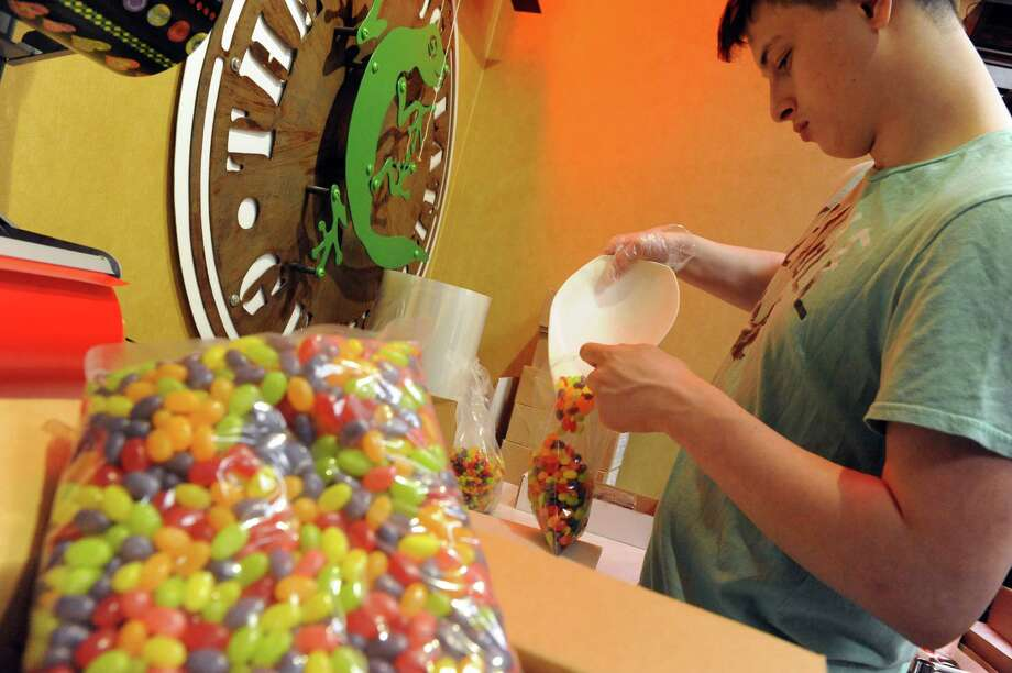 Eithan Reynolds fills bags of jelly beans at Uncle Sam's Candy in Newton Plaza on Friday March 25, 2016 in Loudonville, N.Y. (Michael P. Farrell/Times Union) Photo: Michael P. Farrell / 10035970A