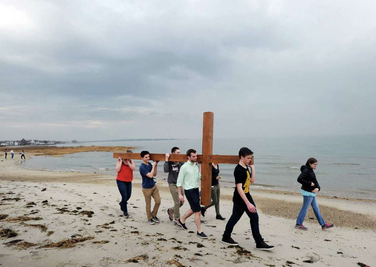 Second from right, Drew Mohn, 16, leads the First Congregational Church of Greenwich youth cross walk onto Greenwich Point beach, Good Friday afternoon, in Old Greenwich, Conn., March 25, 2016. The cross was carried by alternating members of the youth group from the First Congregational Church in Old Greenwich to Greenwich Point, a distance of a little more than 2 miles, where it will be used for the sunrise service on Easter Sunday morning. Donald Haviland, a youth group minister at the church who was supervising the event, said about 15-20 youth group members took part. Youth group member Daniel Lepoutre, 16, said about the cross walk,