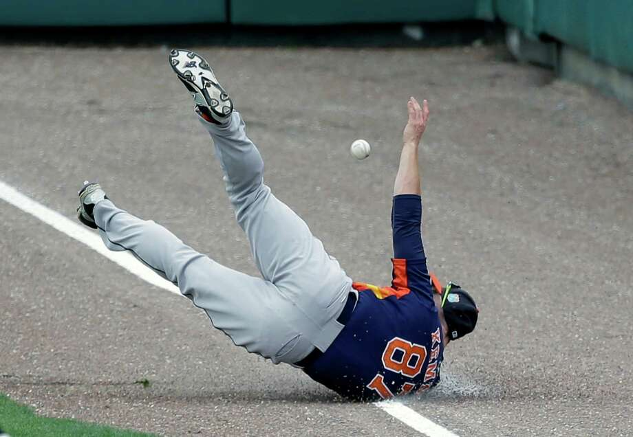 Houston Astros outfielder Jon Kemmer is unable to field a fly ball which resulted in a double by Atlanta Braves' Gordon Beckham in the sixth inning of a spring training baseball game, Friday, March 25, 2016, in Kissimmee, Fla. Photo: John Raoux, AP / Copyright 2016 The Associated Press. All rights reserved. This material may not be published, broadcast, rewritten or redistribu