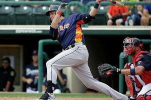 Houston Astros' Matt Duffy hits a double in the second inning of a spring training baseball game against the Atlanta Braves, Friday, March 25, 2016, in Kissimmee, Fla.