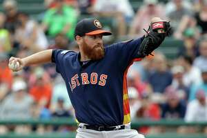 Houston Astros' Dan Straily pitches against the Atlanta Braves in the first inning of a spring training baseball game, Friday, March 25, 2016, in Kissimmee, Fla.