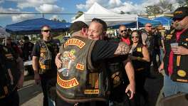 Jeff Pike, former Bandidos Motorcycle Club president, center-right, is greeted by members at the group's 50th anniversary party Saturday, March 12, 2016, in Kingwood.