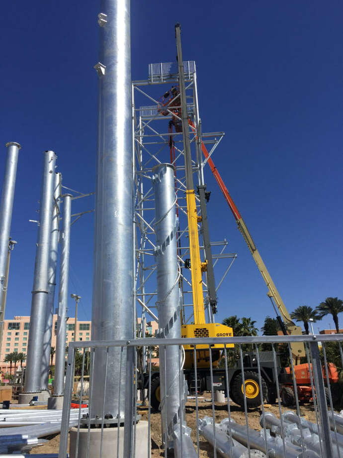 Construction workers at Schlitterbahn Waterpark on Galveston Island lay the first pieces Friday, March 25, 2016 of a new feature called MASSIV. Once finished, MASSIV will be the world's tallest water coaster. Photo: Schlitterbahn Courtesy Photo