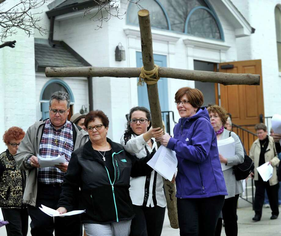 Carrying the cross are from left, Debbie Caraluzzi, Val Massimo and Patty Garrison. Left is Tony Caraluzzi, a deacon at St. Mary Church and the organizer of the walk. Christian churches in Bethel joined together in an ecumenical Stations of the Cross service in observance of Good Friday,  March 25, 2016. The day marks the crucification of Jesus Christ, three days before Easter. Photo: Carol Kaliff / Hearst Connecticut Media / The News-Times