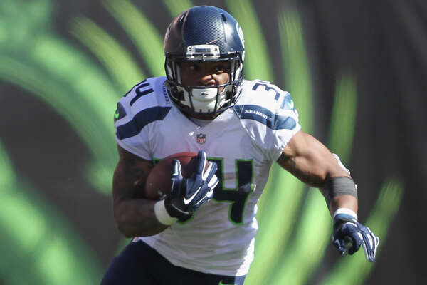 CINCINNATI, OH - OCTOBER 11:  Thomas Rawls #34 of the Seattle Seahawks runs the football upfield  during the game against the Cincinnati Bengals at Paul Brown Stadium on October 11, 2015 in Cincinnati, Ohio. The Bengals defeated the Seahawks 27-24.