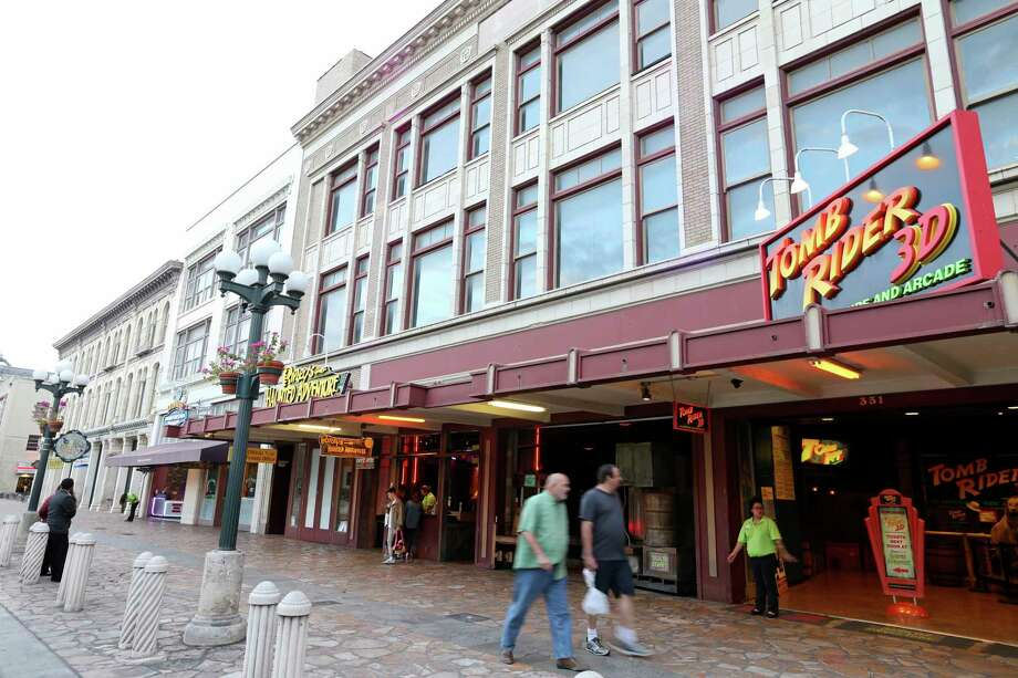 San Antonio should not hand over our streets, nor allow the demolition of the Woolworth and other historic buildings. Instead, the city should San Antonio buy back those buildings. Photo: Staff File Photo / © 2015 San Antonio Express-News
