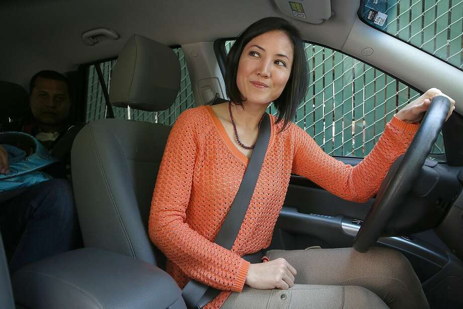 "Uber driver Kathy Allen, a single mom, says some aspects of the bonus program are murky. ""If you create a metric that you base people's pay on, you need to be transparent about it. You should give workers the ability to track it and tell them how it's calculated,"" Allen says. Photo: Liz Hafalia, The Chronicle"
