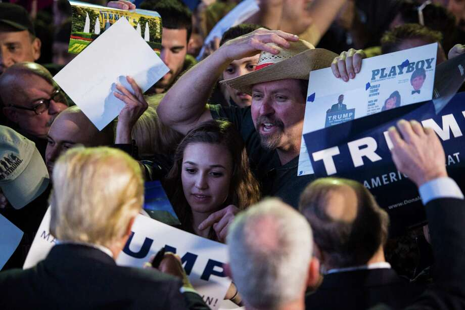 Donald Trump has inarguably tapped into a real sense of white grievance. Supporters reach out to the Republican presidential candidate during a campaign event at Winner Aviation in Vienna, Ohio on March 14. Photo: Jabin Botsford /The Washington Post / The Washington Post