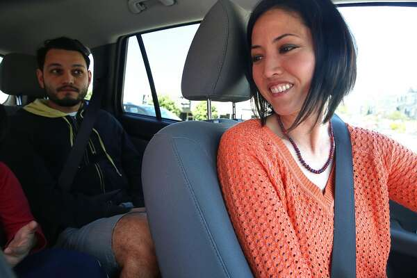Driver and veteran Kathy Allen picks up Uber pool customer Erick Espinosa in San Francisco, California, on friday, march 25, 2016.