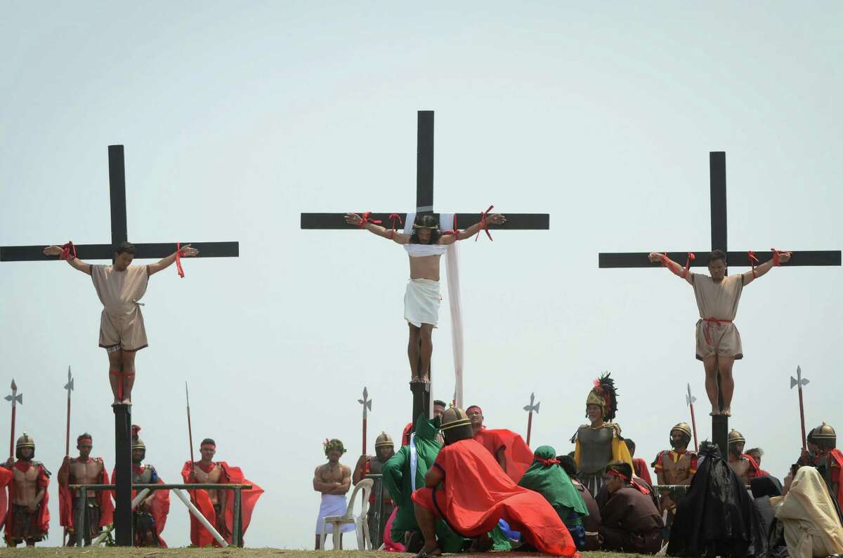 SAN FERNANDO, PAMPANGA - MARCH 25: Filipino penitents are nailed to the cross during a reenactment of Christ's crucifixion on March 25, 2016 in San Fernando town in Pampanga province, Philippines. The annual crucifixion rites draws huge crowds of people to normally sleepy towns in northern Philippines.