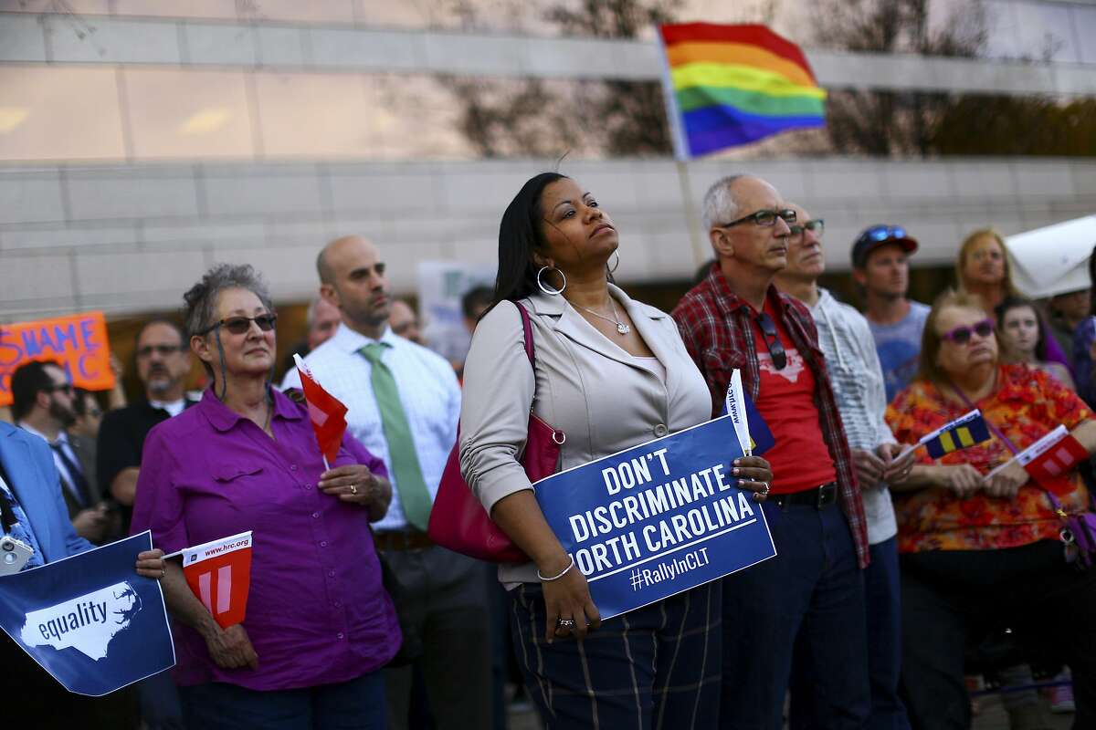 Demonstrators rally outside the Charlotte Mecklenburg Government Center in Charlotte, a day after North Carolina passed a law forbidding cities from enacting anti-discrimination protections for the LGBT community, March 24, 2016. The measure � hastily presented, passed and signed into law in just 12 hours � quickly prompted a wave of criticism from the business community as well. (Travis Dove/The New York Times)