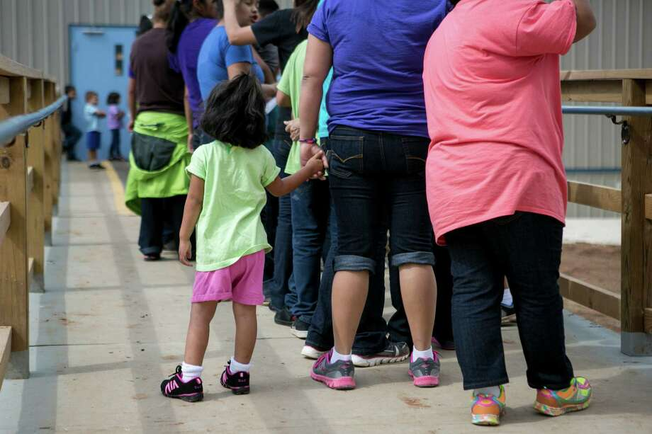In this file photo, residents line up to eat lunch at the South Texas Family Residential Center in Dilley that houses women and children. Immigrant advocates are quite correct. A prison — even a nicer one — is still a prison. Photo: ILANA PANICH LINSMAN /New York Times / NYTNS