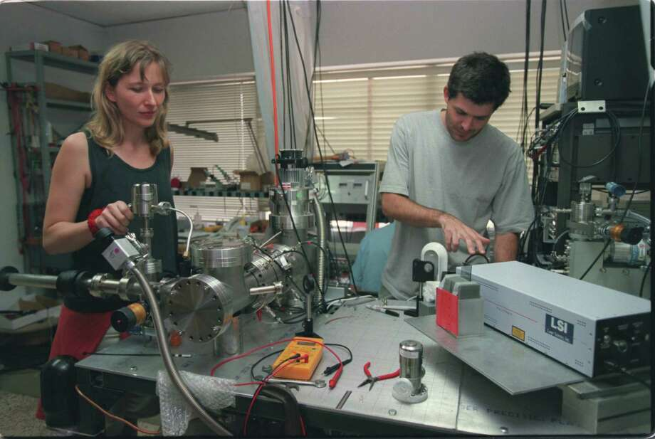 Thsi file photo shows Swiss physicists with H-1B visas working at Ionwerks Co. in Houston. There are many times when companies must look outside of our country for specific talents. Photo: Melissa Phillip /Houston Chronicle / Houston Chronicle